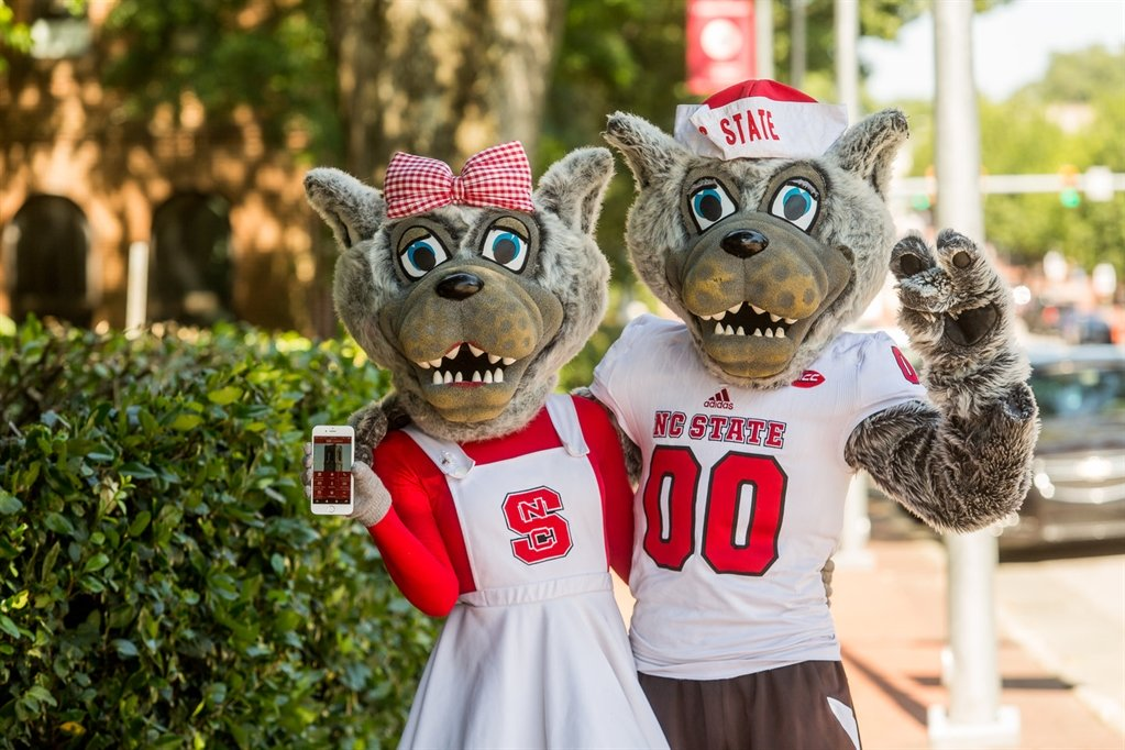 Mr. and Mrs. Wuf with the Alumni Association App.