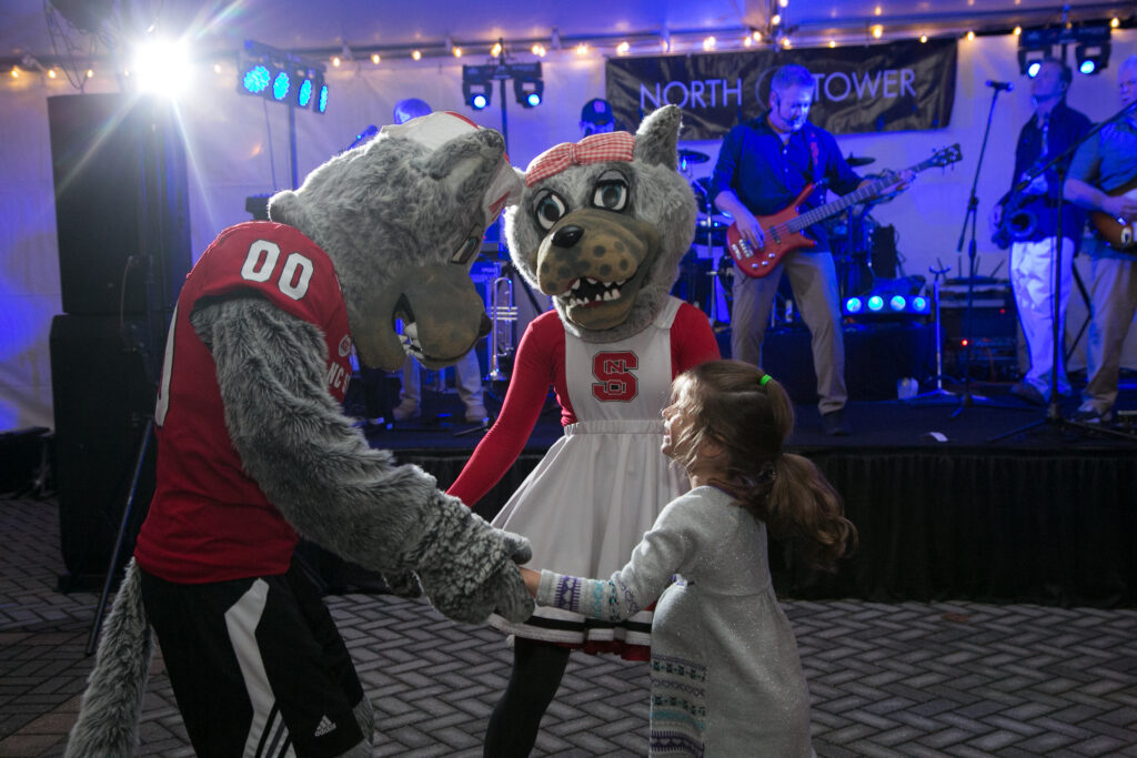 Mr. and Mrs. Wuf dancing at Packapalooza.