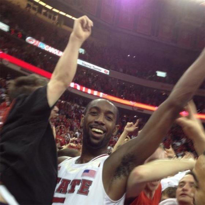 Will Privette being held up by CJ Leslie during the court storming.