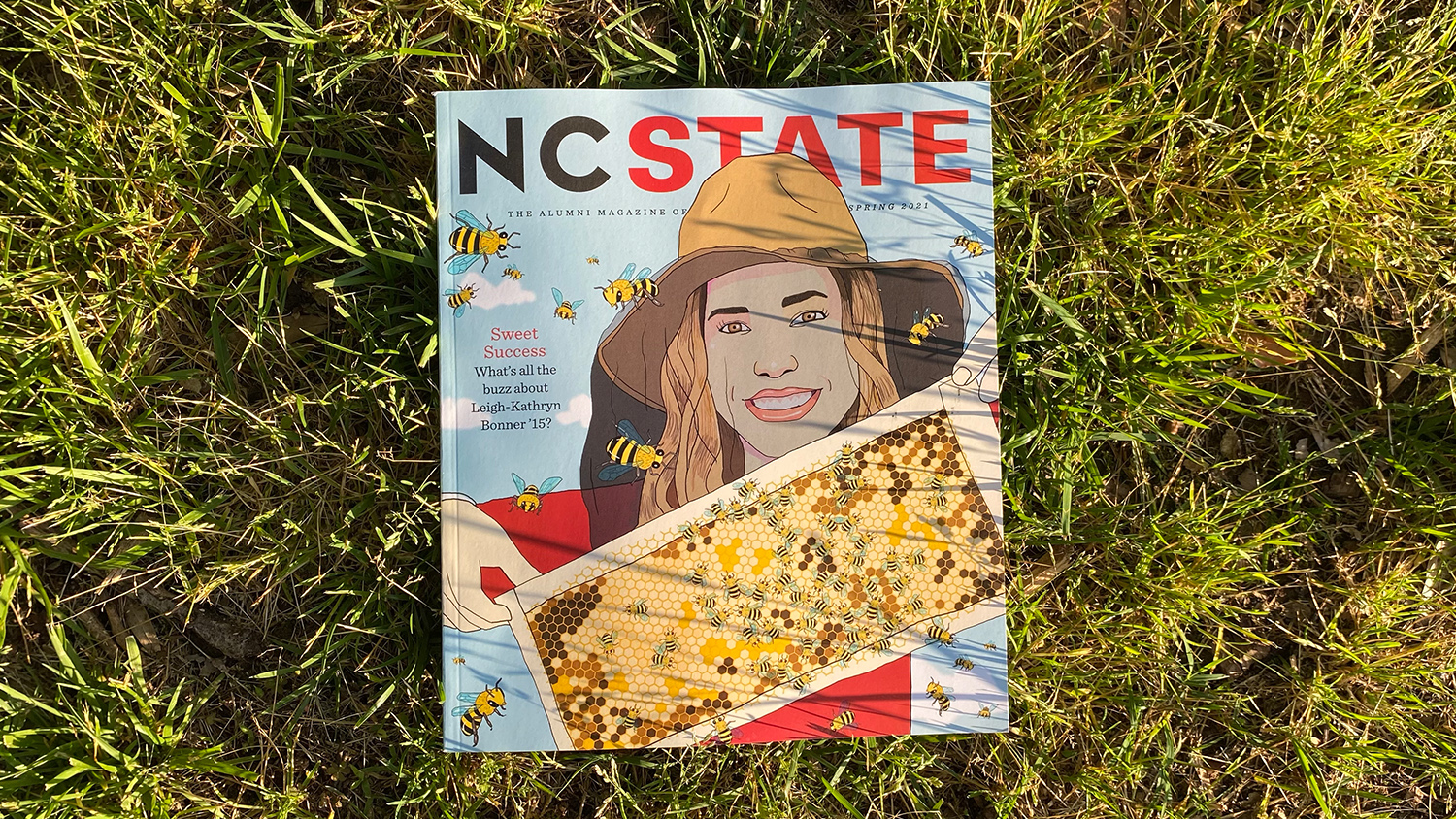 The Spring 2021 issue laying in grass during golden hour.
